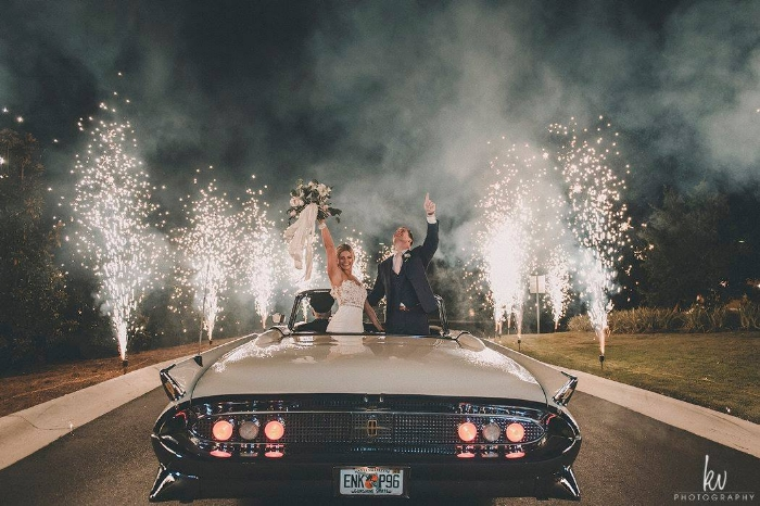 lisa stoner events- lisa stoner events- four seasons orlando- grand exit- classic car- sparkler exit - luxury weddings in orlando.jpg