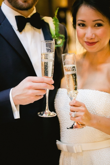 lisa stoner events- bride and groom - champagne toast- etched champagne glasses- editorial styling - oxford exchange- tampa bay weddings.jpg