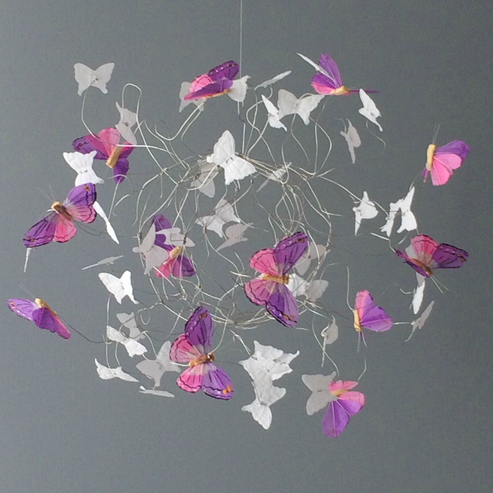 White Butterfly Mobile in a Medium size with pops of purple and pink butterflies ...about 12 inches in diameter. Made to Order with some Ready to Ship at ButterflyOrbs shop.