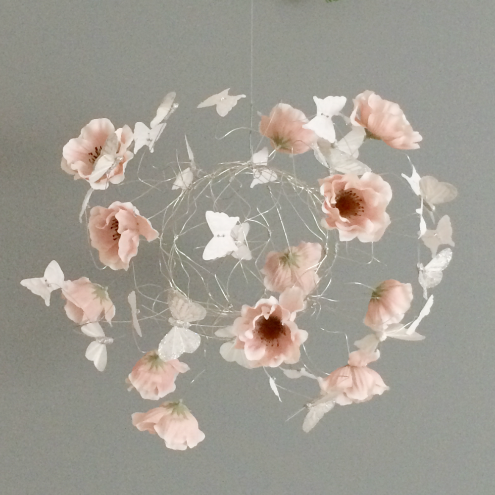 This lovely mobile has peach flowers and a touch of silver butterflies as well as white fabric butterflies. See more and more details at the shop.