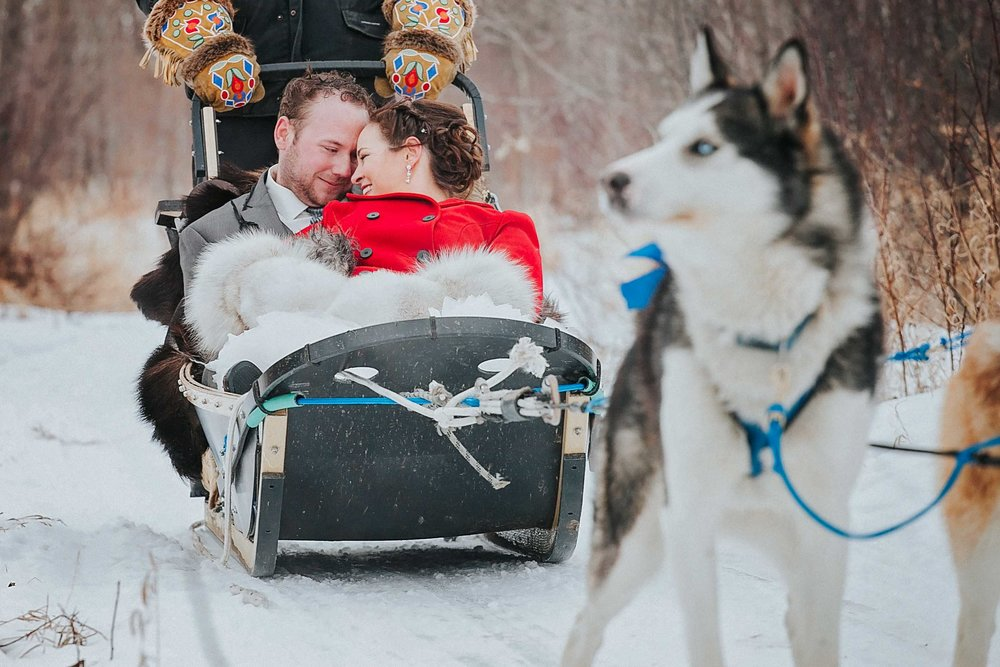 "Jay + Jackie got married in a very warm and tropical place with a few friends and family, but they wanted to have something here, close to home, so everyone could get together and celebrate.  These two had a celebration at Asessippi Ski Area & Resort.  It was a very cold wintery day. That didn't stop these two, to jumping in a dog sled that they had right at the resort.  What a ride!! To capture these beautiful images, I am excited to say that I had the joy of riding a snowmobile backwards over this crazy terrain. You would never believe how cold it was, with how much cuddling that was going on.                        Normal   0           false   false   false     EN-US   JA   X-NONE                                                                                                                                                                                                                                                                                                                                                                               /* Style Definitions */ table.MsoNormalTable 	{mso-style-name:""Table Normal""; 	mso-tstyle-rowband-size:0; 	mso-tstyle-colband-size:0; 	mso-style-noshow:yes; 	mso-style-priority:99; 	mso-style-parent:""""; 	mso-padding-alt:0cm 5.4pt 0cm 5.4pt; 	mso-para-margin:0cm; 	mso-para-margin-bottom:.0001pt; 	mso-pagination:widow-orphan; 	font-size:12.0pt; 	font-family:Cambria; 	mso-ascii-font-family:Cambria; 	mso-ascii-theme-font:minor-latin; 	mso-hansi-font-family:Cambria; 	mso-hansi-theme-font:minor-latin;}          Enjoy!"