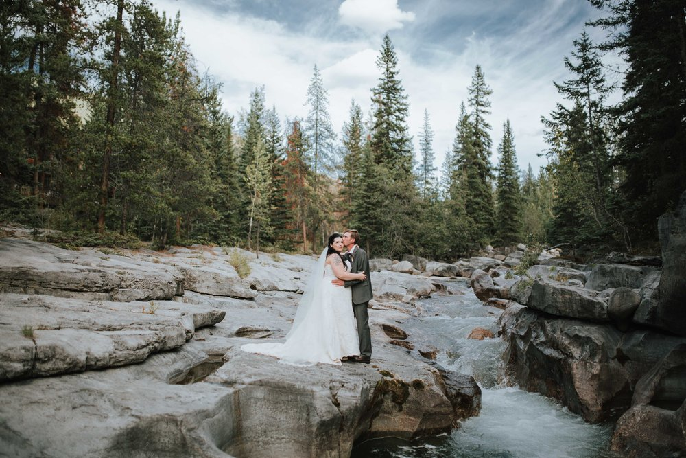 Mountains and trees and water, oh my! This Alberta wedding had it all! Jasper, Ab Mountains were the perfect choice for Courtney and Grant's free-spirited wedding day. The couple spent a romantic afternoon exploring the mountainside and the forest below and let's not forget jumping over waterfalls at Maligne Canyon. Oh my, it was AMAZING!  Everything was jaw-droppingly beautiful, and each image shows off the couple's intense and unique love for one another.