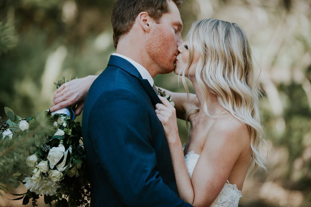 Nestled deep in the woods, Travis and Courtnee's romantic inspired wedding was a charming affair that marked this couple's first steps in their biggest adventure yet. Their sweet color palette of blush rose and navy, surrounded with all the greenery made this day ultra romantic in every way, and you're about to see why!