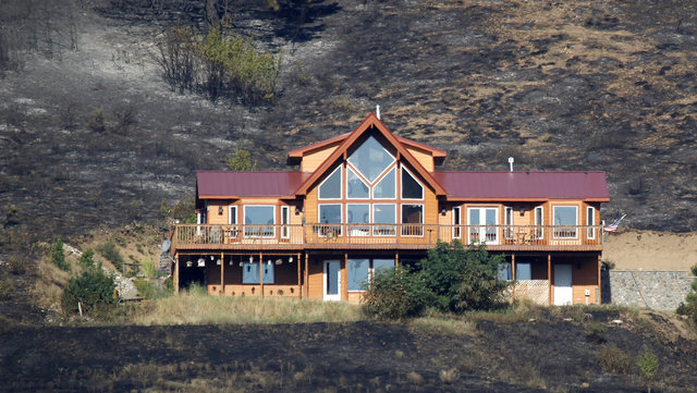 A home saved by defensible space.