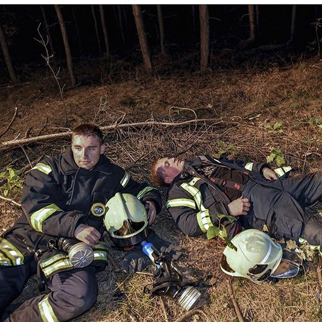 Two firefighters rest following their deployment in Brandenburg, Germany. Some 300 firefighters are battling a forest fire that evacuated three villages just south of Berlin. Photography by @patrick.pleul. Repost from @time.