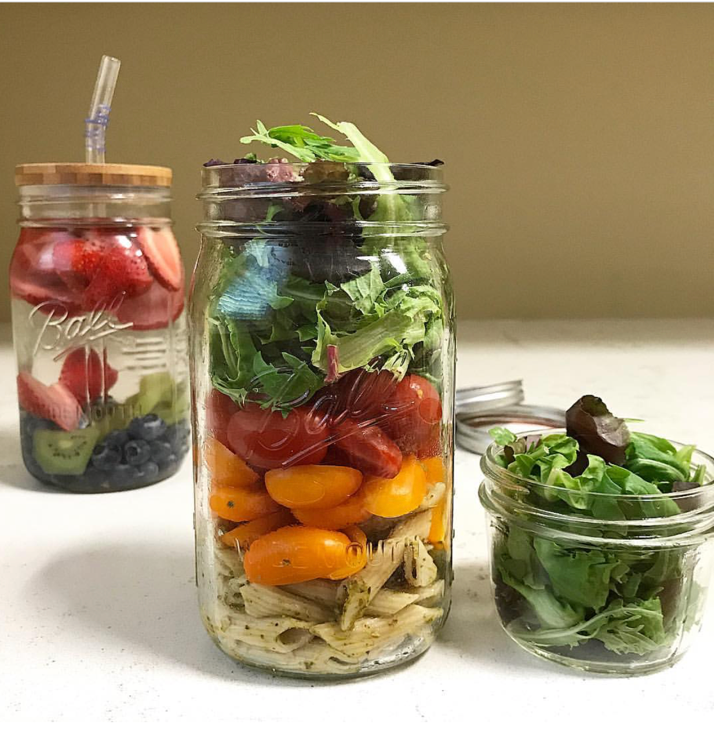 Photo by @_takingmylifeback featuring reusable glass jars for prepped food storage and featuring Hummingbird Straws on the left.