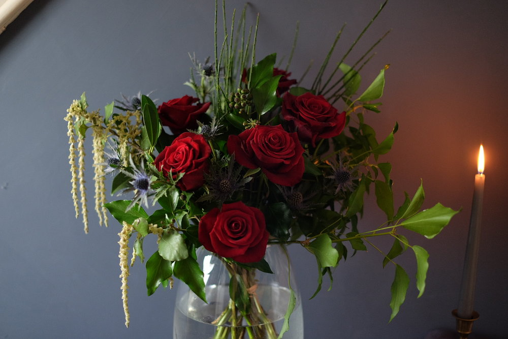 Red roses in a hand tied DIY bouquet