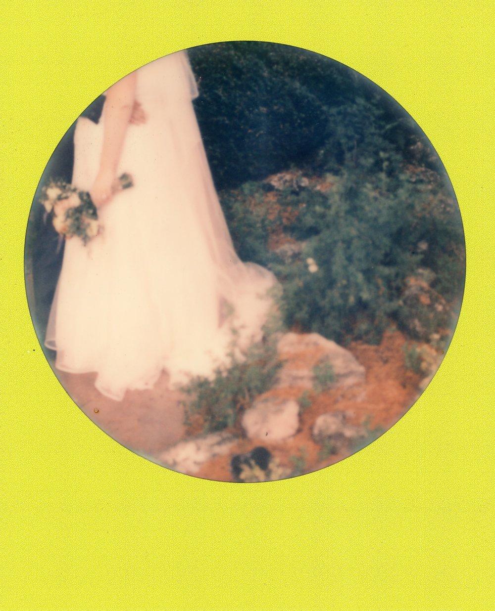 Coloured framed Polaroid of Sarah's dress at Barton Hall Hotel Preston