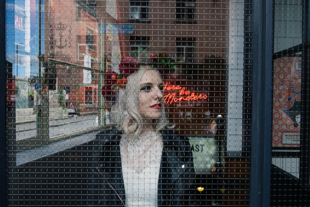 Martha the model stands inside of a bar in the northern quarter Manchester