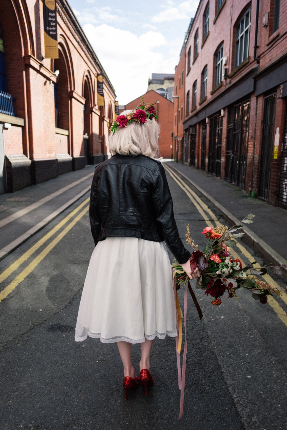 Martha walking down the back streets of the northern quarter Manchester