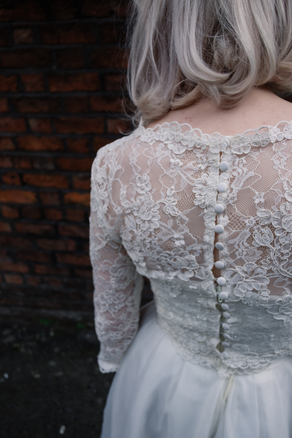 Showing the back detail with small buttons on the handmade dress by Wilderness Bride