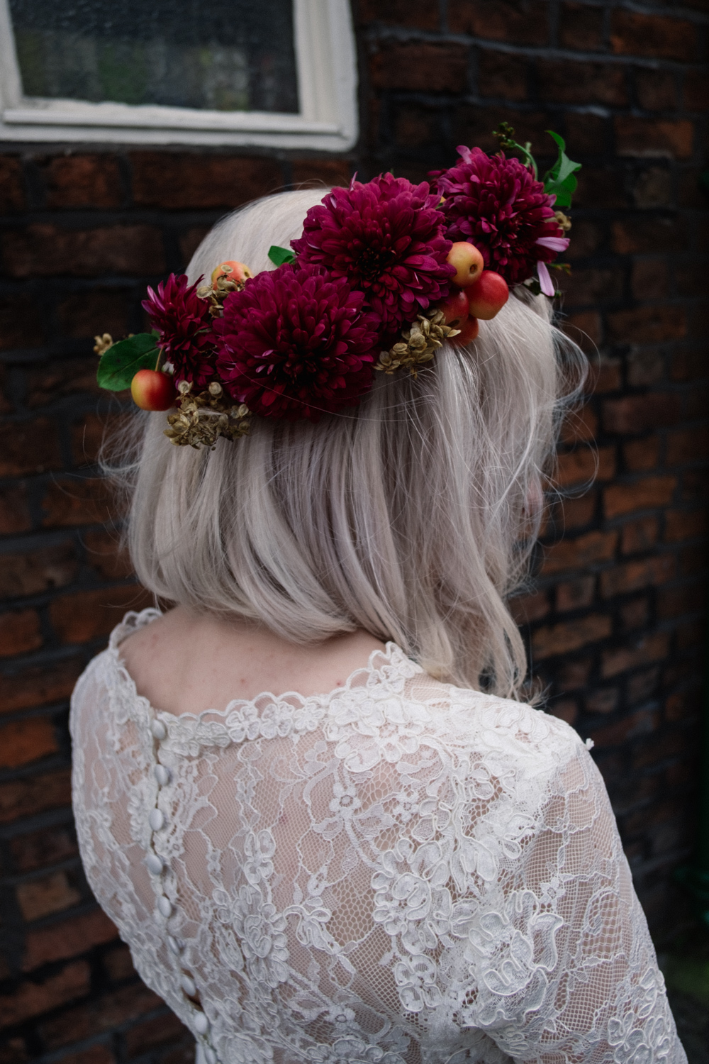 Martha showing the lace from the back of her dress and showing her flower crown