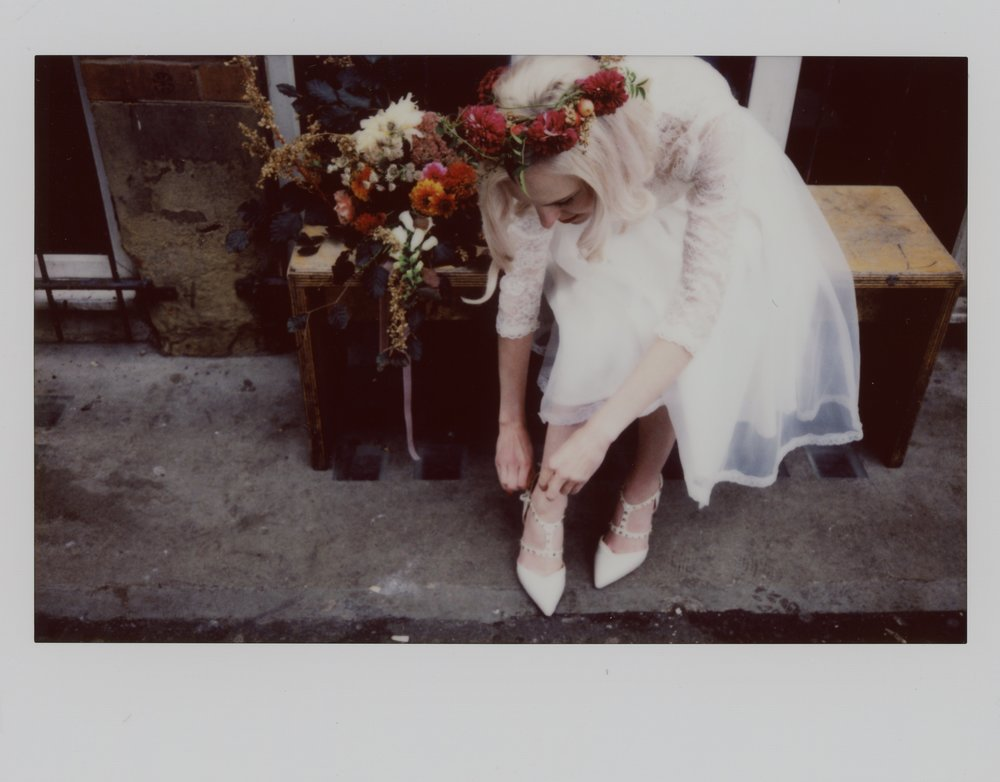 Instax wide photo of Martha in her Wilderness Bride wedding dress