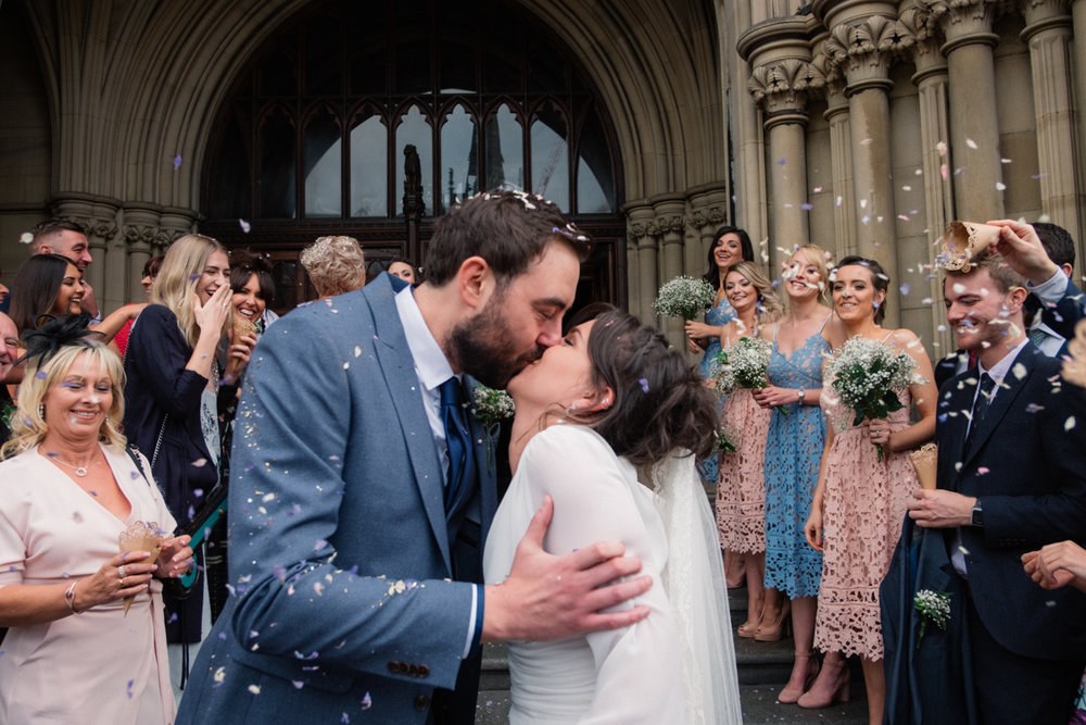 Esther and Sean kissing at Manchester town hall