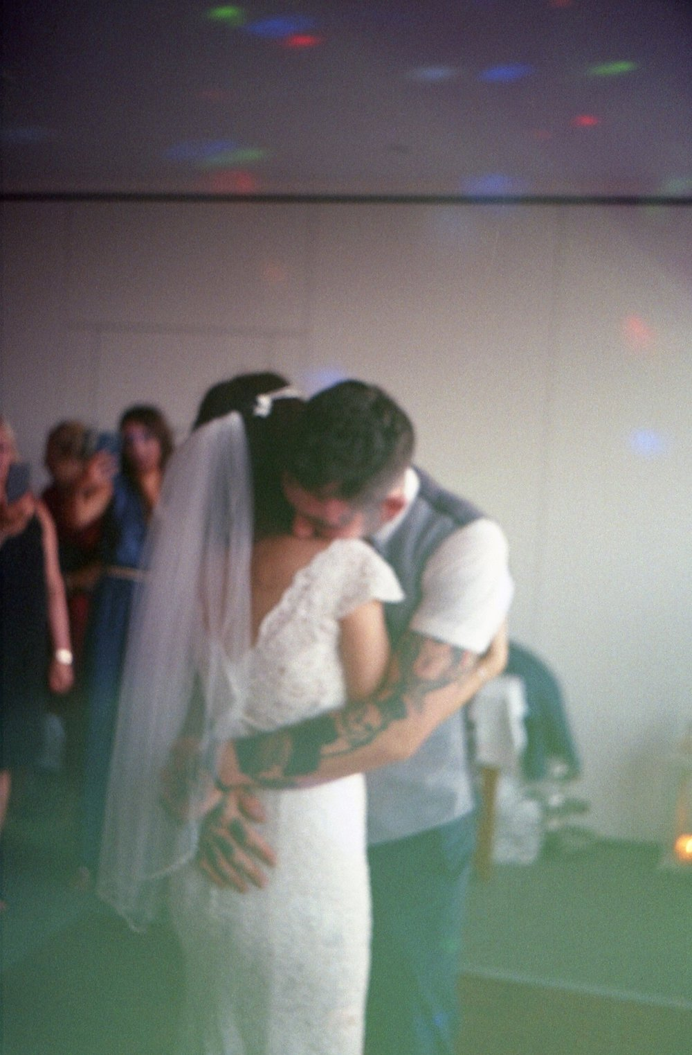 Chantelle and Simon hugging. Taken with an Olympus Trip