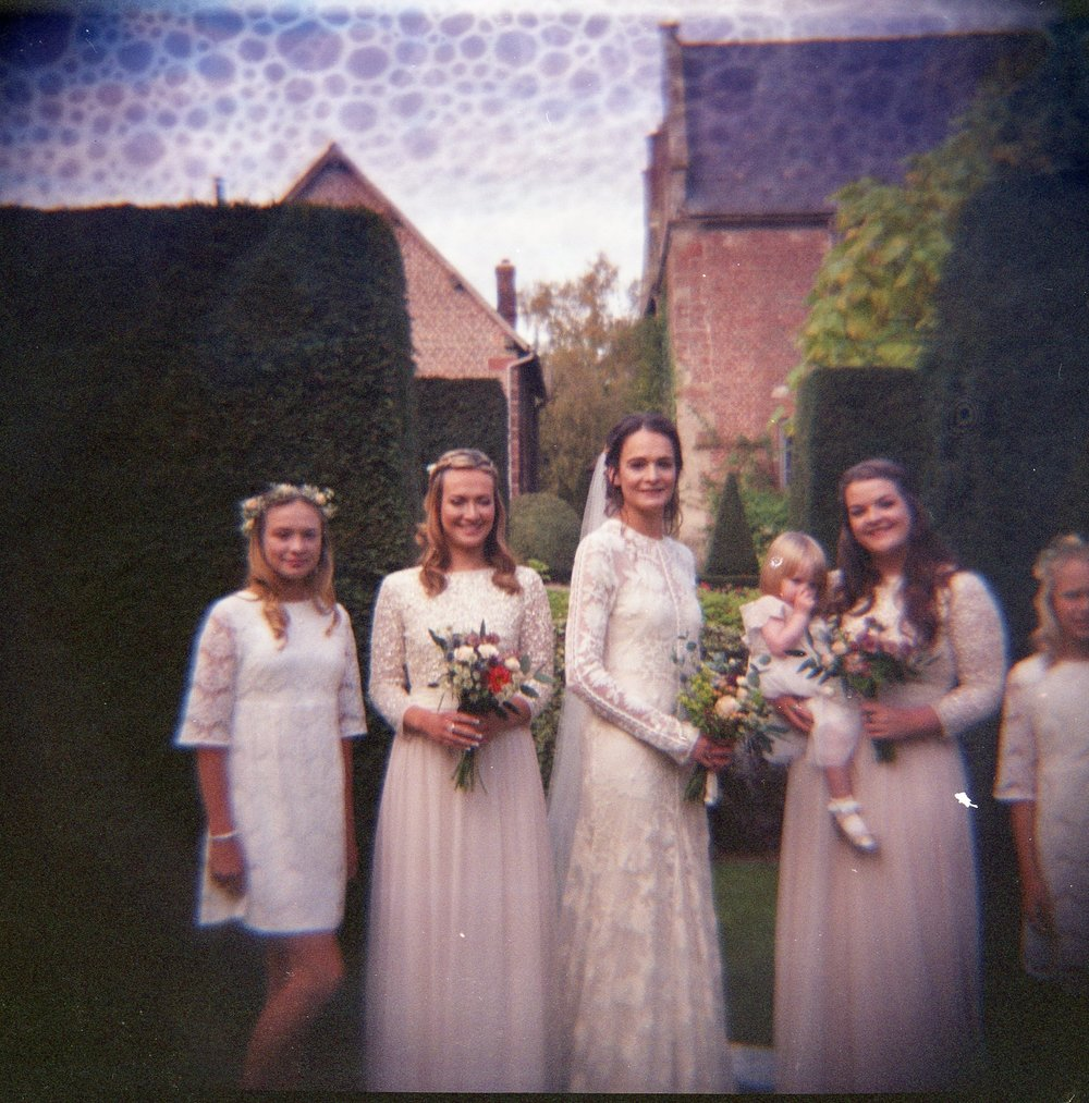 Camilla and bridemaids at Pimhill barn on diana camera