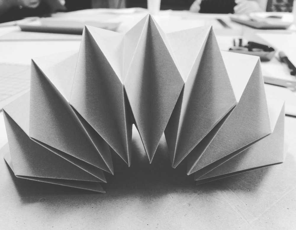 Shadows are the negatives of light. They give shape and direction, and can be easily captured with paper and a light source.  We create paper models for rapid prototyping, using techniques learned from kirigami and origami as well as bookbinding handicraft.
