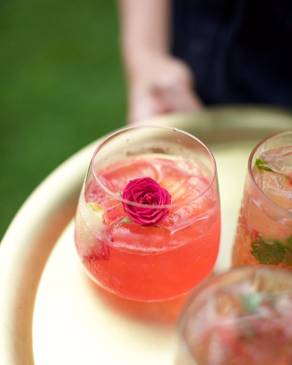 ROSEJITO   rose petals, fresh pressed lime, house rose syrup, fresh raspberry-infused vodka, float of bubbly