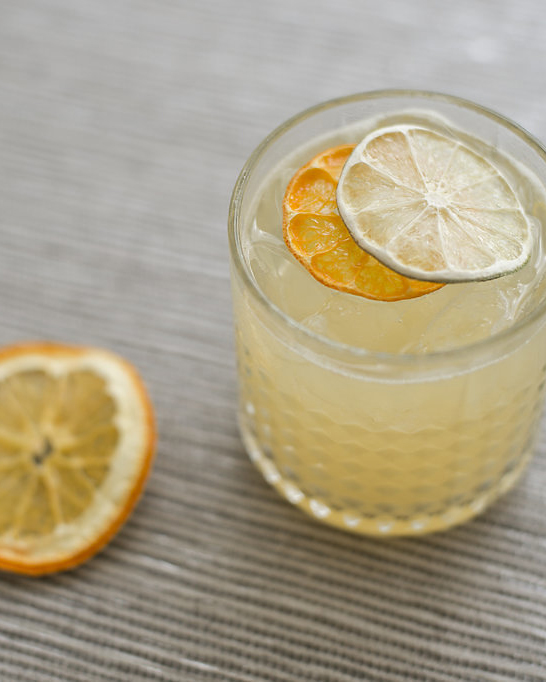 SURF BREAK   fresh pressed tangerine and lime, simple syrup, sea salt mist, blanco tequila