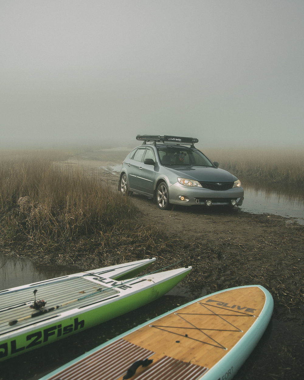 Setting up our paddle boards in the fog.