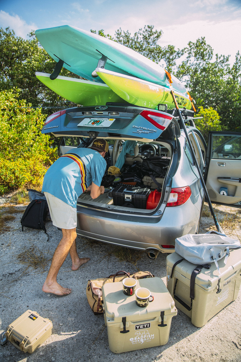 Erick unloading gear from the back of his Subaru