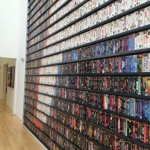 Copy of VHS shelf contains 7,000 tapes