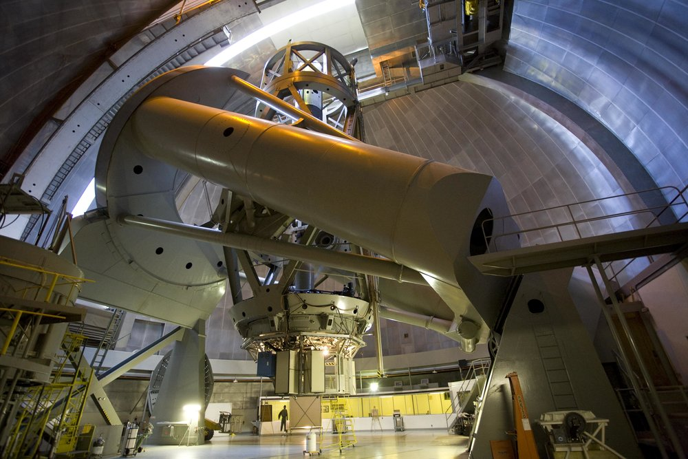 """Figure 1: """"The 200-inch (5.1 m) Hale Telescope (f/3.3) was the world's largest effective telescope for 45 years (1948-1993). It is still a workhorse of modern astronomy. It is used nightly for a wide range of astronomical studies. On average the weather allows for at least some data collection about 290 nights a year.""""\(^{[1]}\)  Image credit:Caltech/Palomar Observatory"""