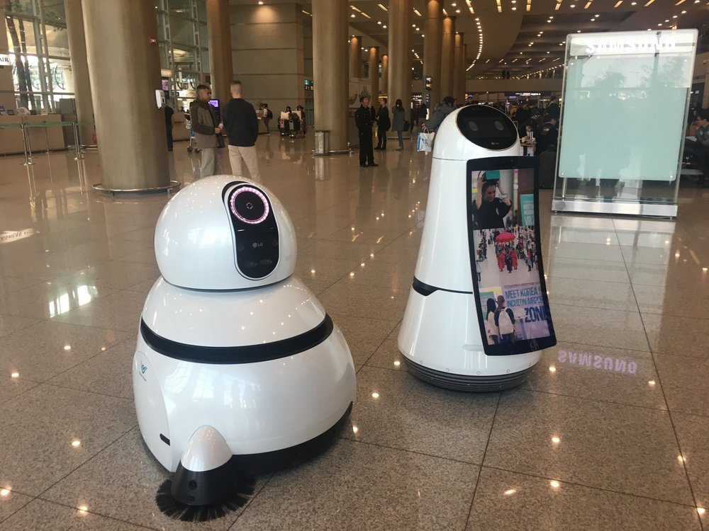 The two robots above help clean the floor and give directions to passengers at the Seoul-Incheon International Airport.
