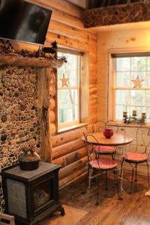 Stones collected from Lake Superior surround this warm, cozy fireplace.