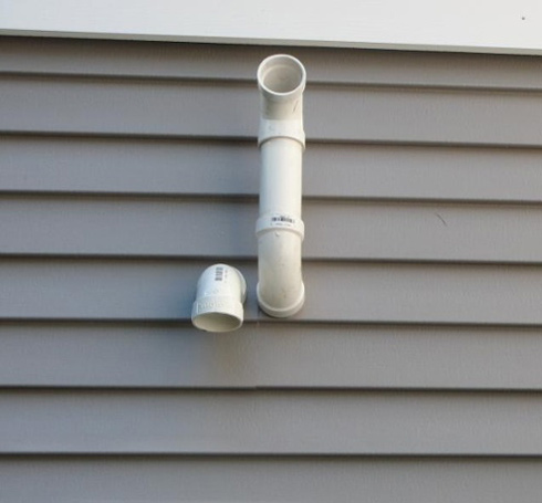 Intake and exhaust vents terminated on side of house.