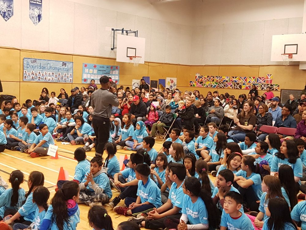 Speaking to a group of students and parents about reaching their dreams at a classroom champions community event in Surrey, BC