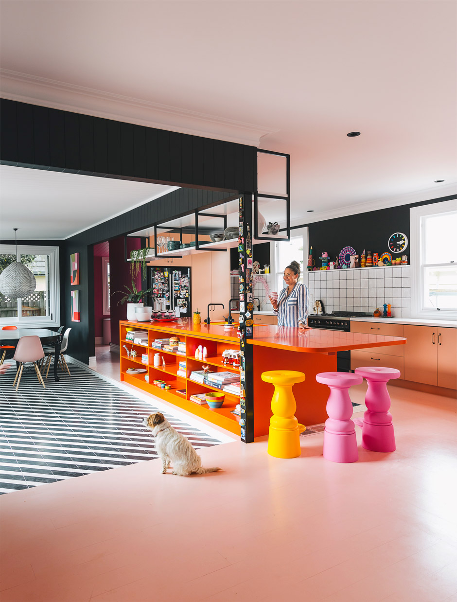 Why yes that is a black and blush kitchen with a flash of orange, not to mention super stripes, so much fun! Image from Homestyle NZ, Photographer Duncan Innes