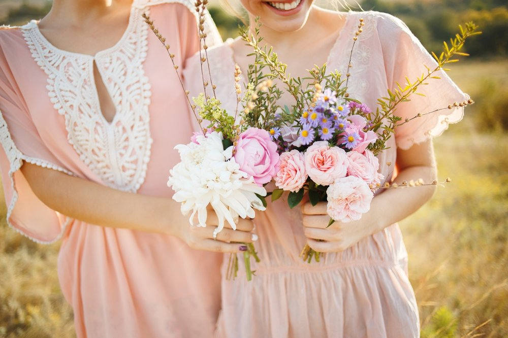 beautiful bridesmaids with bouquets in their hands.jpg