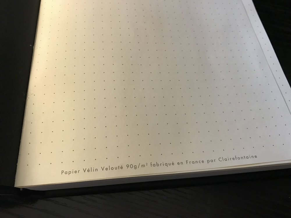 Rhodia proudly touts the quality of their paper right there on page one. The remainder of the pages are dot grid with no further markings. Page one is glued to the endpaper; it's the only page that doesn't really want to lie flat.
