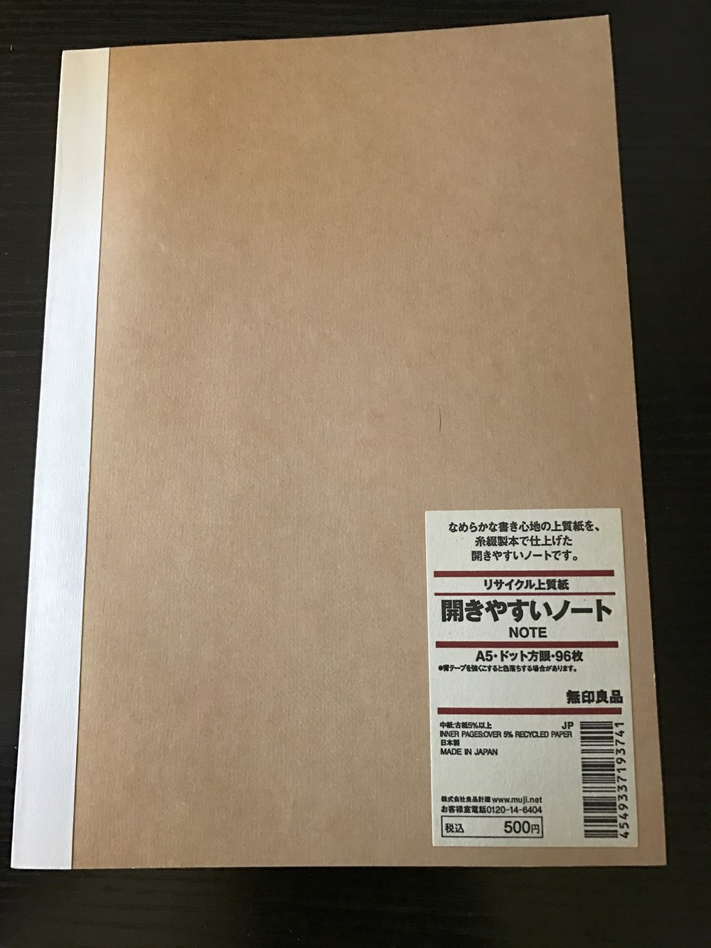The MUJI notebook has an unassuming appearance.