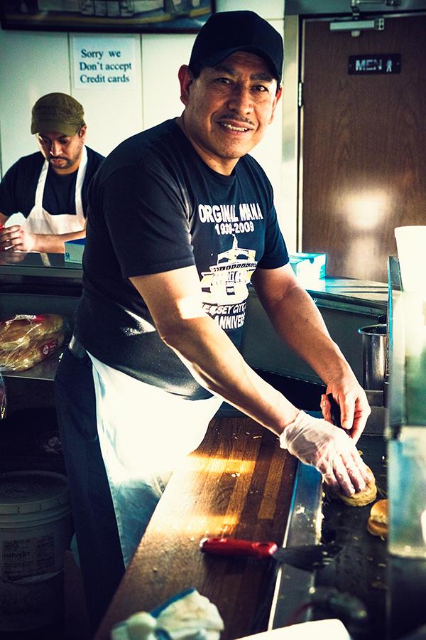 Edwin preparing the burgers
