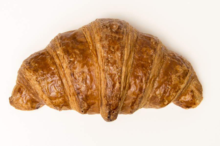 Croissant -  the quintessential pastry, flaky and buttery.