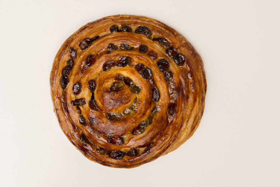 Escargot - named after a snail shell as that's what it looks like when baked.  It's actually pastry dough spread with vanilla bean custard and sultanas.