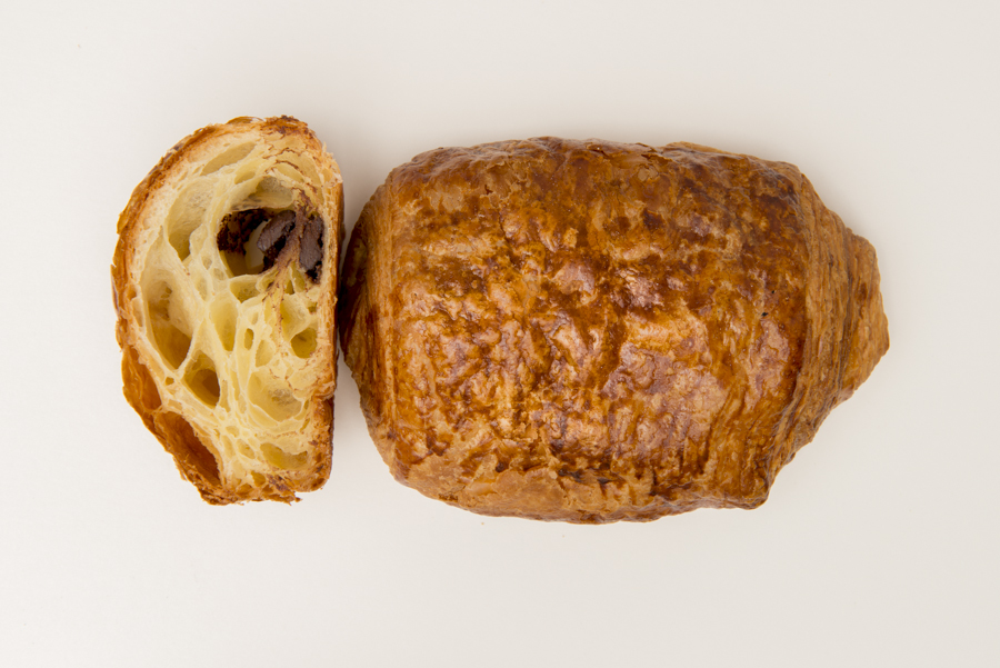 "Chocolate Croissant -  Or ""pain au chocolat"" in French, folds of flaky pastry dough with couverture chocolate centre."