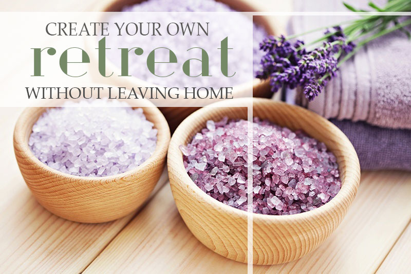 image of purple bath salts with some lavender and a fluffy bath towel for creating your own home retreat