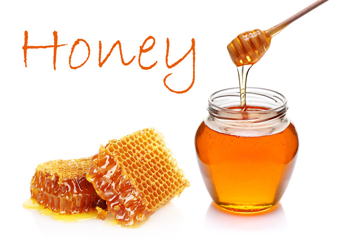 a jar of honey with some raw honeycomb has many health benefits but use in moderation