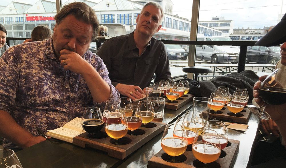 How are  these  men describing their beers?