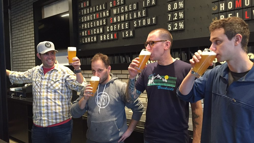 The men from Breakside drinking the first pints at the new Slabtown brewery and pub.