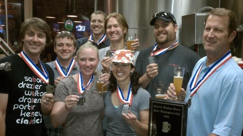 The only photo I could find of Gary Fish (far right) with medals--though not the GABF. Source: Deschutes Brewery