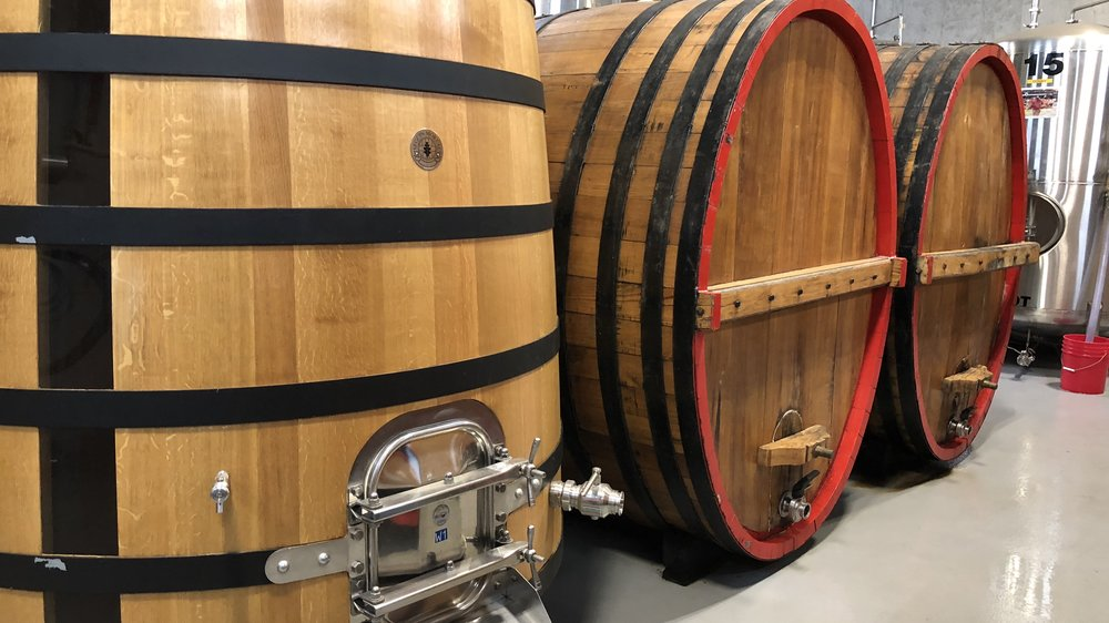 "The Deschutes barrel room, which includes hundreds of wine casks in addition to these foeders, is known around the brewery as ""Oakland"" or ""Wood World."""
