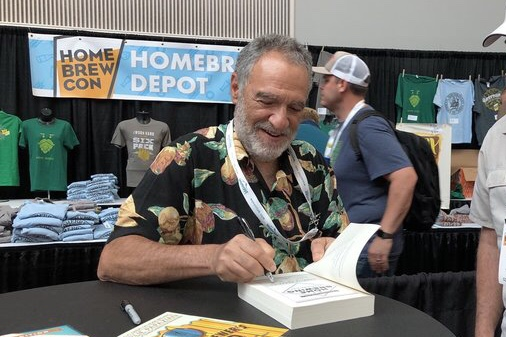Charlie signing books at Homebrew Con in Portland in 2018