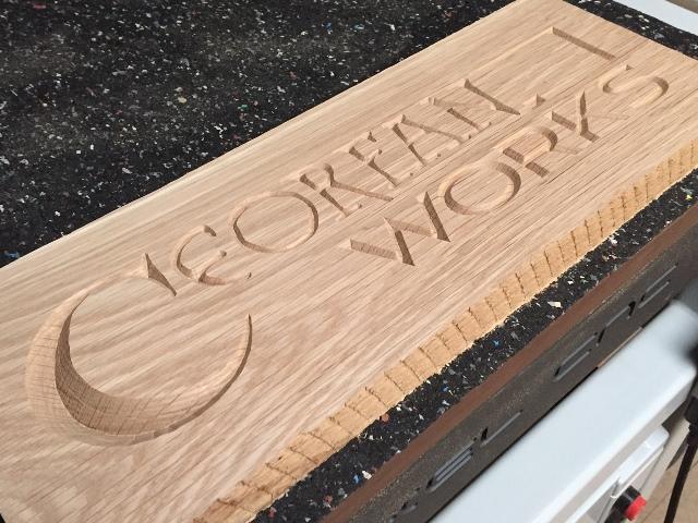 CeorfanWorks logo carved into oak.