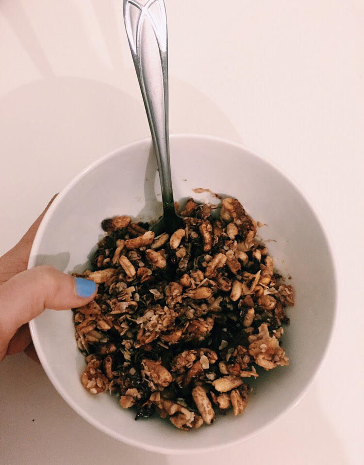 DARK CHOCOLATE GRANOLA    Ingredients   ·       Kamut puffs (1/2 cup)  ·       Cashews (1/2 cup) – may sub any nut of your choice)  ·       Rolled oats (1/2 cup)  ·       Dark chocolate chips (1/4 cup)  ·       Coconut flakes (1/4 cup)  ·       Coconut oil (enough to coat pan – 1-2 tbsp should be enough)  ·       Raw honey (2-3 tbsp, depending on how sweet you want your granola)   Directions   ·       Preheat oven to 350 degrees and coat baking sheet with coconut oil  ·       Mix kamut puffs, cashews, dark chocolate chips, coconut flakes, and rolled oats in a bowl  ·       Add raw honey - mix  ·       Pour mix onto baking sheet, distributing evenly  ·       Bake for 15 minutes