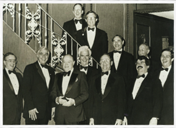 The original ten members with Bob Hope after performing at a dinner in honor of Princess Grace of Monaco in 1981. Back row: Wayne Barber, Rich McGlynn, Joe Caron, Bill Soons, Ward Dorer. Front row: Roger Englander, Don Selby, Mr. Hope, Bill Moore, John Dorer, Gordon McLaren.