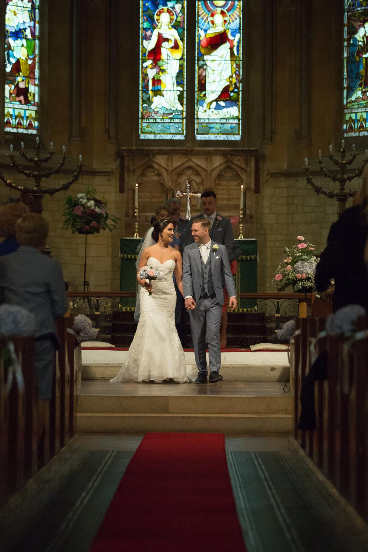 wedding couple leaving church